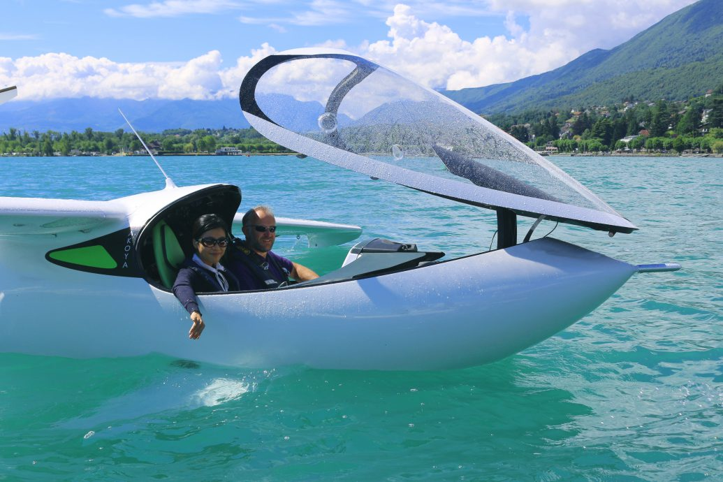 Personal airplane floating on water with opened canopy