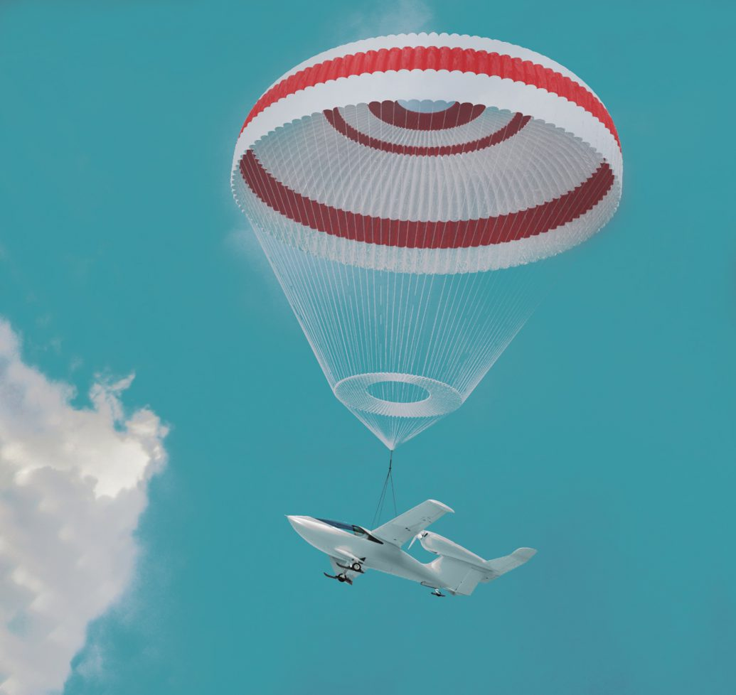 Light aircraft with emergency parachute in a blue sky