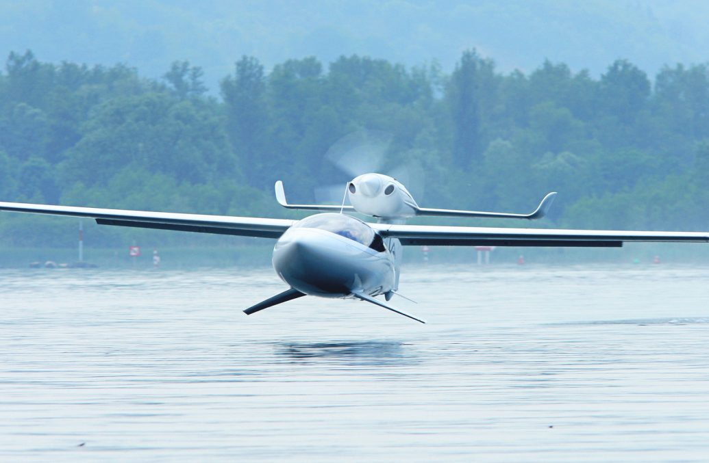 AKOYA seaplane with hydrofoils above water